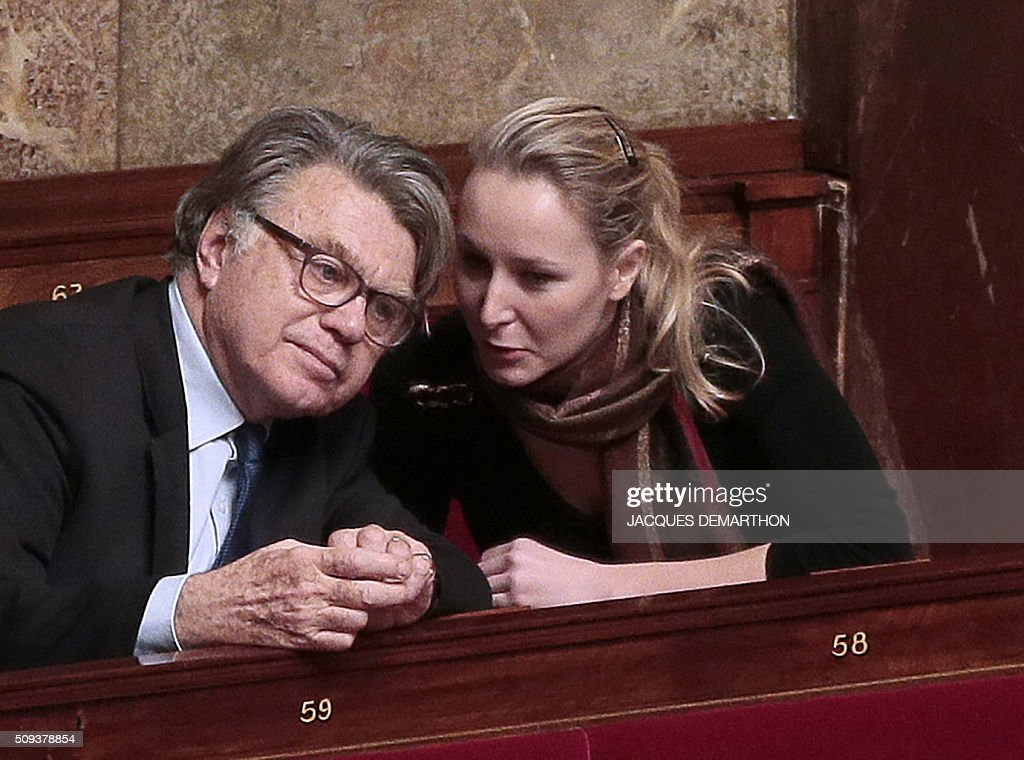 French far-right wing party members and MPs Gilbert Collard (L) and Marion Marechal-Le Pen (R) attend a session of political guidelines ('Explications de vote') before a vote on the draft-law on 'protection of the Nation' at the National Assembly in Paris on February 10, 2016. French lawmakers were to vote on February 10 on a controversial package of measures to change the constitution following the terror attacks on Paris in November. / AFP / JACQUES DEMARTHON