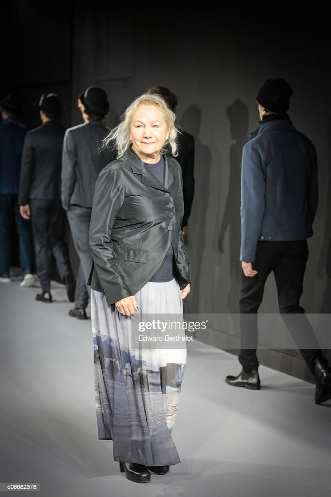 French fashion designer Agnes B. acknowledges the public applause after the Agnes B. Menswear Fall/Winter 2016-2017 show as part of Paris Fashion Week on January 24, 2016 in Paris, France.