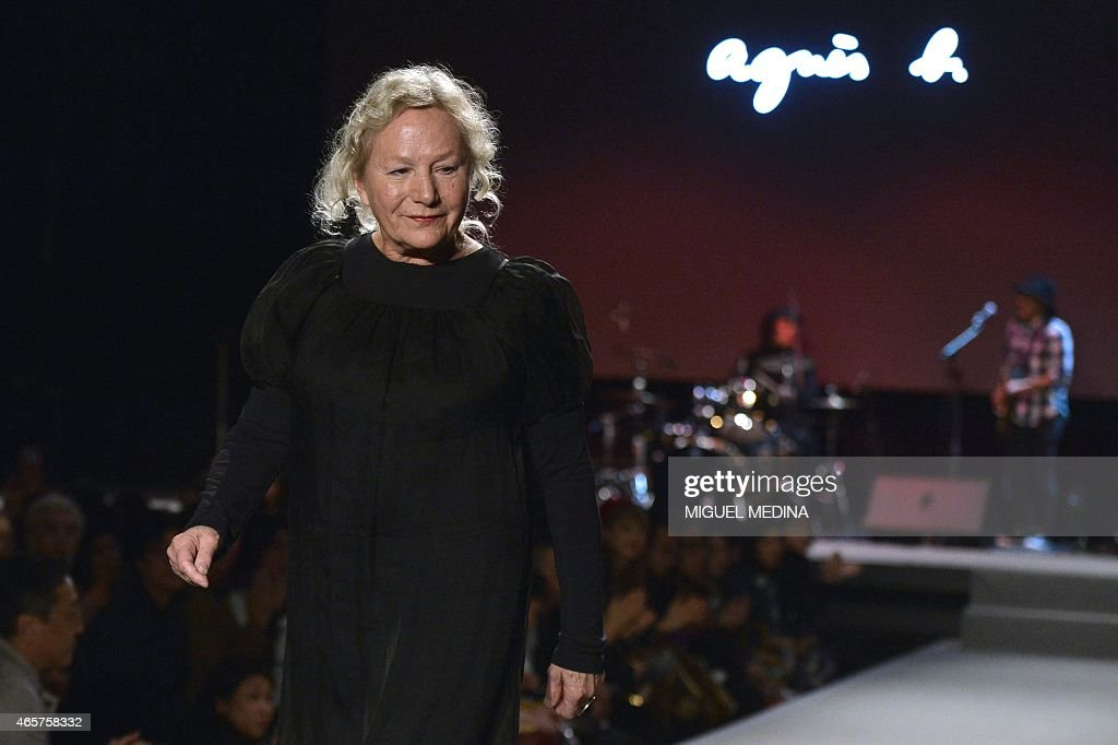 French fashion designer Agnes b. acknowledges the public at the end of her 2015-2016 fall/winter ready-to-wear collection fashion show on March 10, 2015 in Paris.