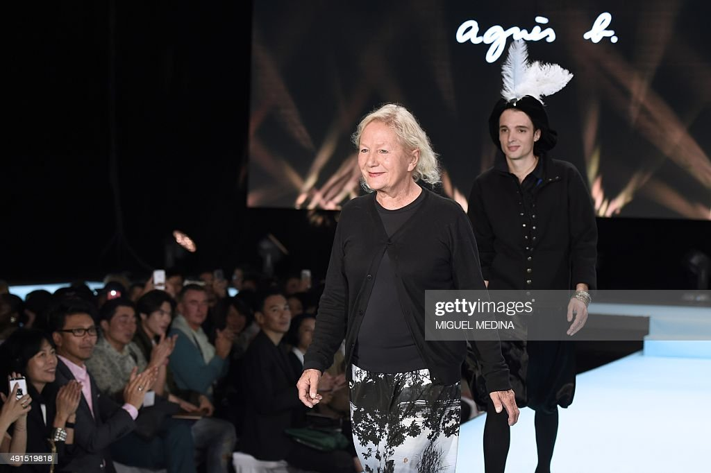 French fashion designer Agnes B. acknowledges the public at the end of her 2016 Spring/Summer ready-to-wear collection fashion show, on October 6, 2015 at the Grand Palais in Paris.