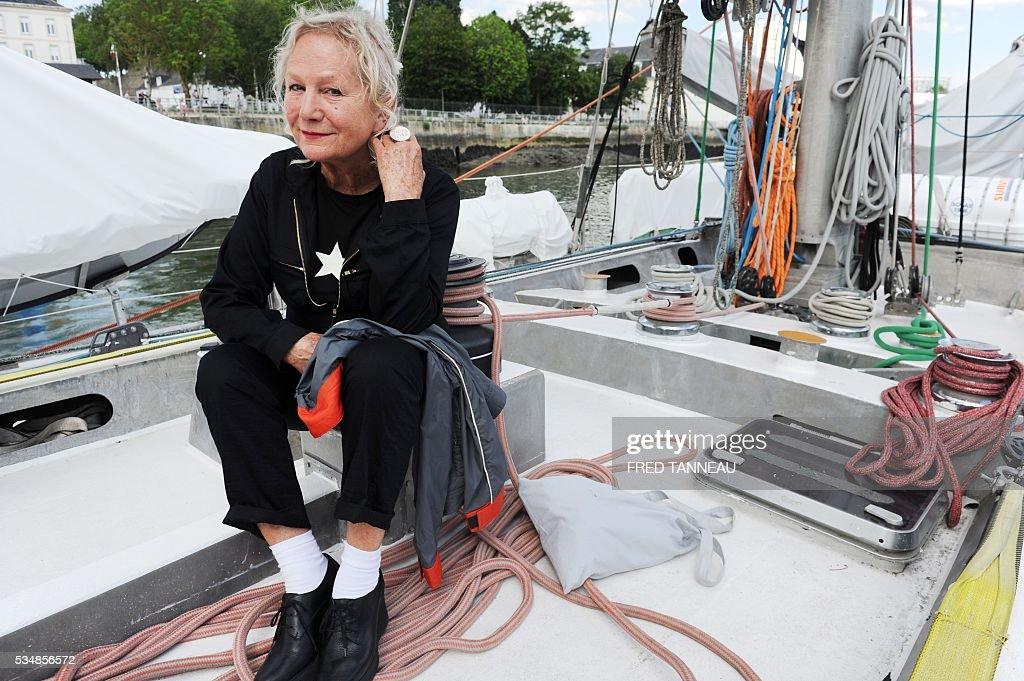 French fashion designer Agnes B poses aboard the Tara boat on May 28, 2016 in Lorient, western France. / AFP / FRED