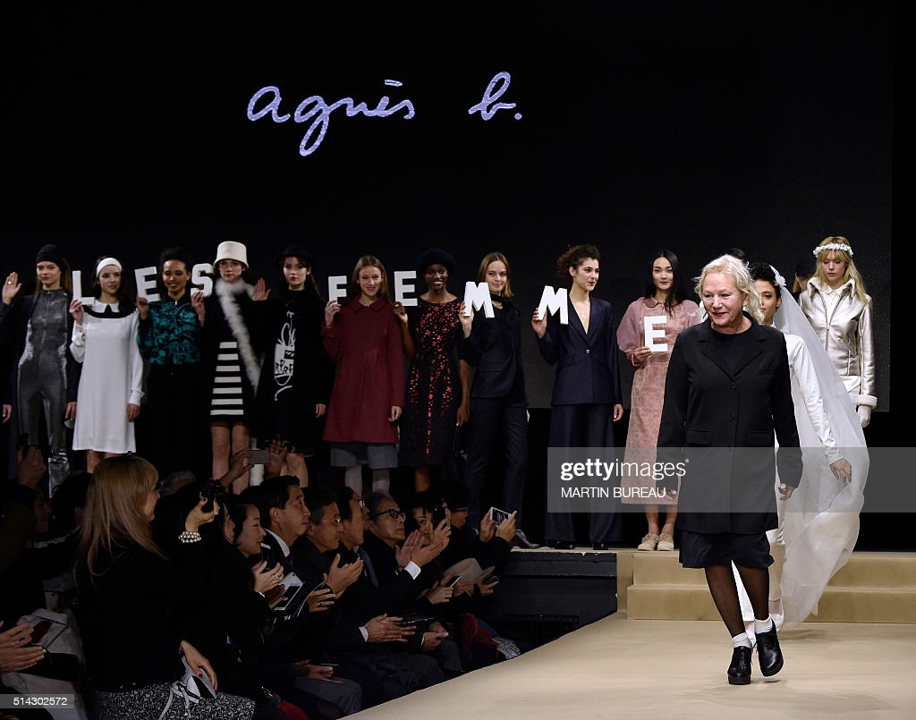 French fashion designer Agnès Troublé acknowledges the audience following the Agnes B during the 2016-2017 fall/winter ready-to-wear collection on March 8, 2016 in Paris. / AFP / Martin BUREAU