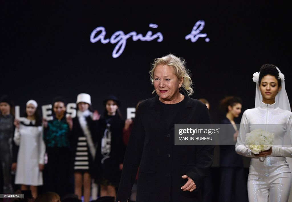 French fashion designer Agnès Troublé acknowledges the audience following the Agnes B during the 2016-2017 fall/winter ready-to-wear collection on March 8, 2016 in Paris. AFP PHOTO / MARTIN BUREAU / AFP / Martin BUREAU