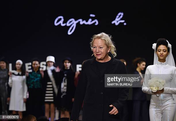 French fashion designer Agnès Troublé acknowledges the audience following the Agnes B during the 20162017 fall/winter readytowear collection on March...
