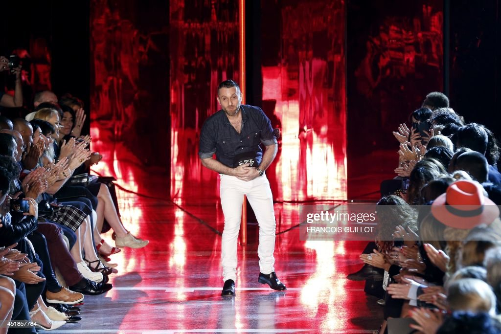 French fashion designer Alexandre Vauthier acknowledges the public at the end of his 2014/2015 Haute Couture FallWinter collection fashion show on...