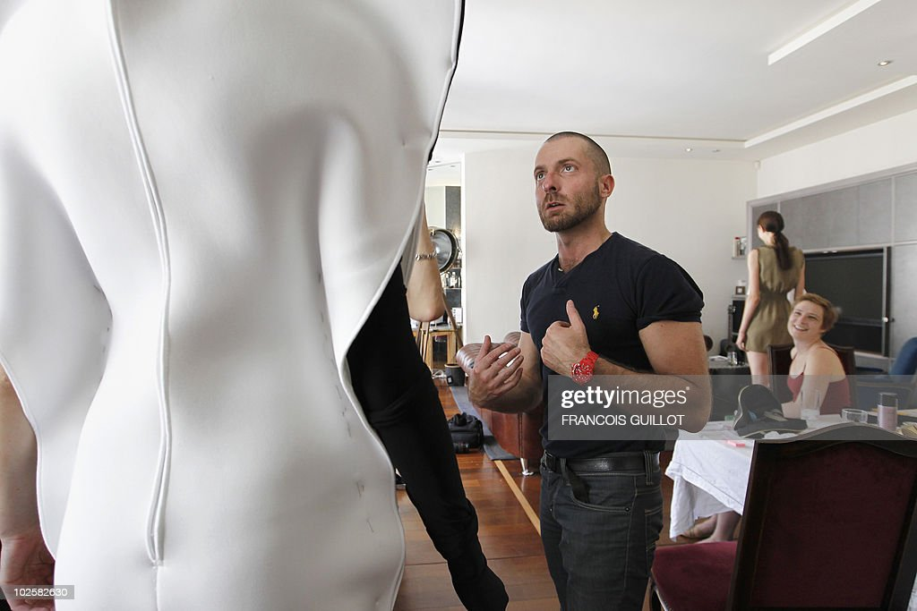 French fashion designer Alexandre Vauthier works on one of a creation worn by a model on July 2 2010 in Paris Vauthier was a member of Thierry...