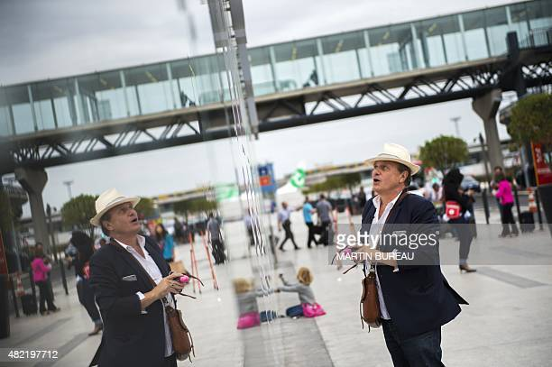 French fashion designer and artist JeanCharles de Castelbajac prepares to draw a design on the walls of ParisOrly aiport on July 28 2015 in Orly AFP...