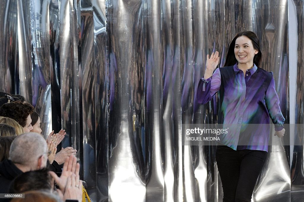 French fashion designer Christine Phung acknowleges the public during her 20152016 fall/winter readytowear collection fashion show on March 3 2015 in...