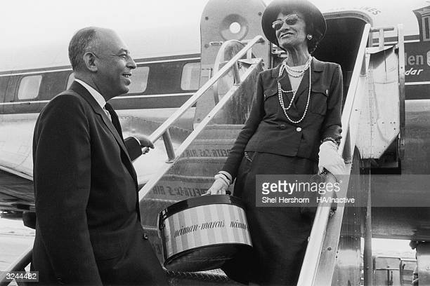 French fashion designer Coco Chanel says goodbye to American department store executive Stanley Marcus as she boards an airplane in Dallas Texas...