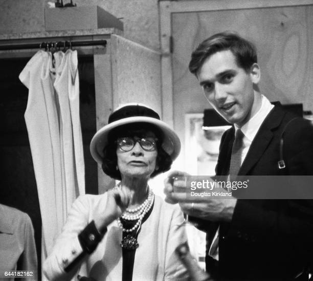 French Fashion designer Coco Chanel with photographer Douglas Kirkland converse in a dressing room