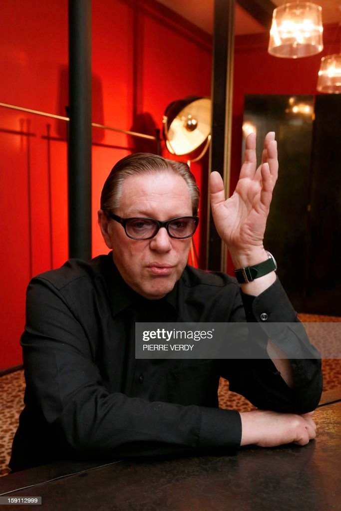 French Fashion designer Herve Leroux poses at his workshop, on January 8, 2013 in Paris.