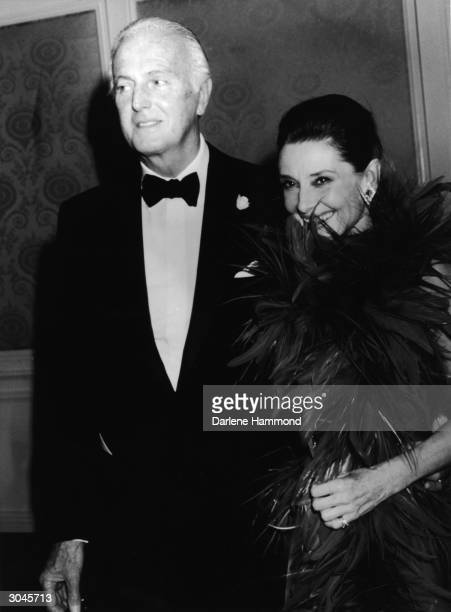 French fashion designer Hubert De Givenchy and Belgianborn actress Audrey Hepburn arrive at an event held in Givenchy's honor where he was awarded...