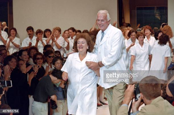 French fashion designer Hubert de Givenchy flanked by his secretary Jeannette acknowledges applause at the end of his Fall/Winter 1995/1996...