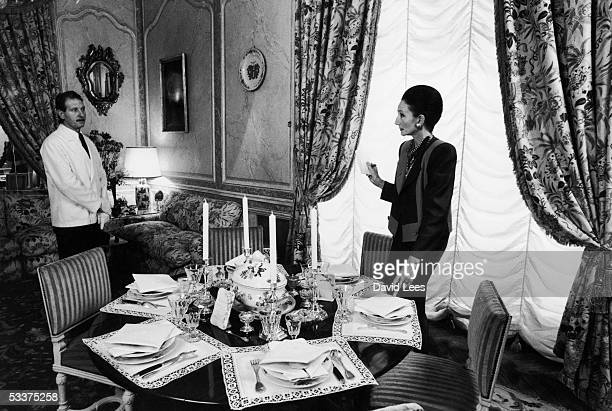 French fashion designer Jacqueline de Ribes speaking to one of her servants at home