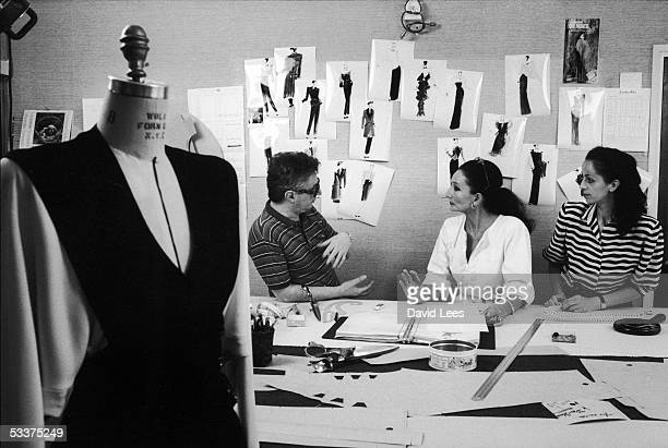 French fashion designer Jacqueline de Ribes working with assistants in her studio