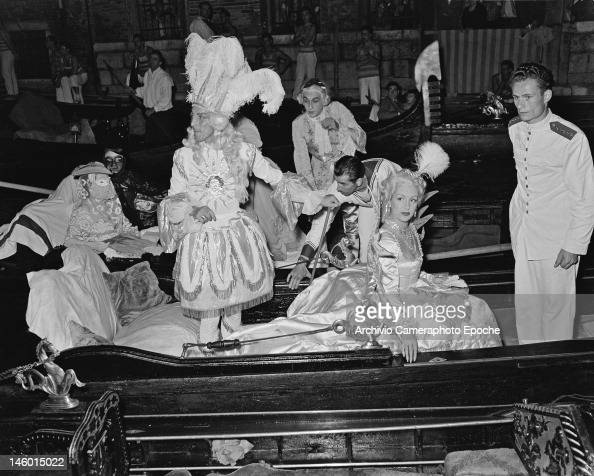French fashion designer Jacques Fath and his wife Genevieve arrive at a masked costume ball at the Palazzo Labia Venice 3rd September 1951 They are...