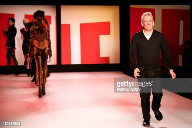 French fashion designer Jean Paul Gaultier acknowledges the public during his Fall/Winter 20132014 readytowear collection show on March 2 2013 in...