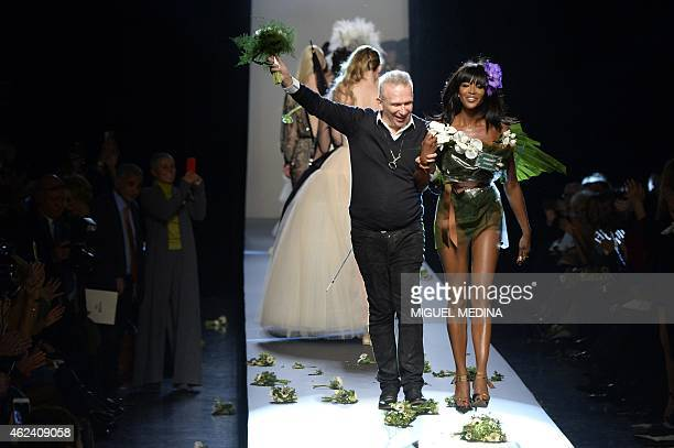 French fashion designer Jean Paul Gaultier acknowledges the public along with British model Naomi Campbell during his 2015 Haute Couture SpringSummer...