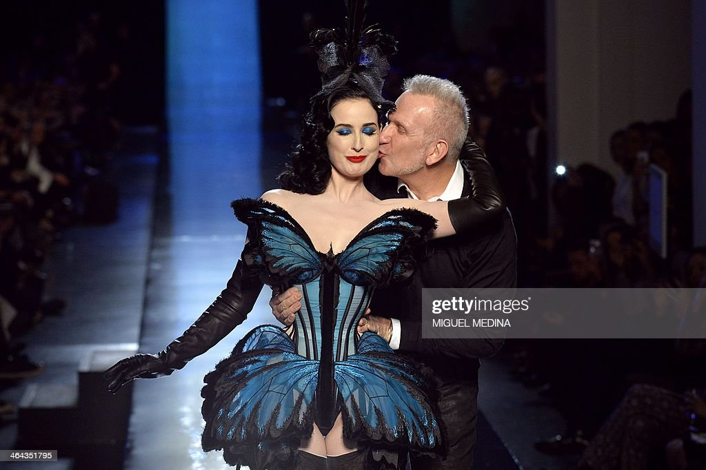 French fashion designer <a gi-track='captionPersonalityLinkClicked' href=/galleries/search?phrase=Jean+Paul+Gaultier+-+Modedesigner&family=editorial&specificpeople=4310036 ng-click='$event.stopPropagation()'>Jean Paul Gaultier</a> acknowledges the public along with US dancer Dita Von Teese during his Haute Couture Spring-Summer 2014 collection show, on January 22, 2014 in Paris.