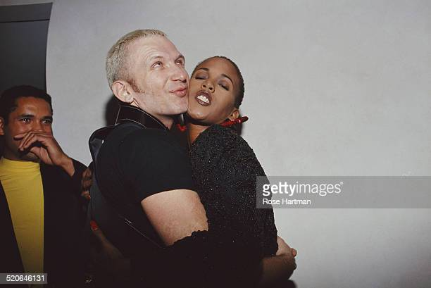 French fashion designer Jean Paul Gaultier and American actress and model Toukie Smith embrace at a private party in SoHo New York City USA circa 1988