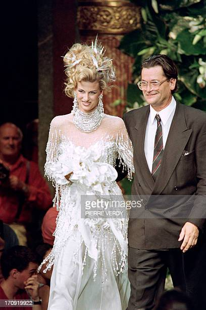 French fashion designer JeanLouis Scherrer walks with his daughter Laetitia in Paris on July 27 1992 during the presentation of his fall/winter...