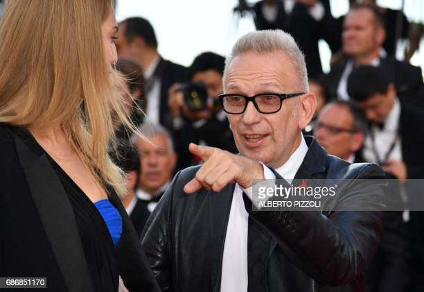 French fashion designer JeanPaul Gaultier gestures as he arrives on May 22 2017 for the screening of the film 'The Killing of a Sacred Deer' at the...