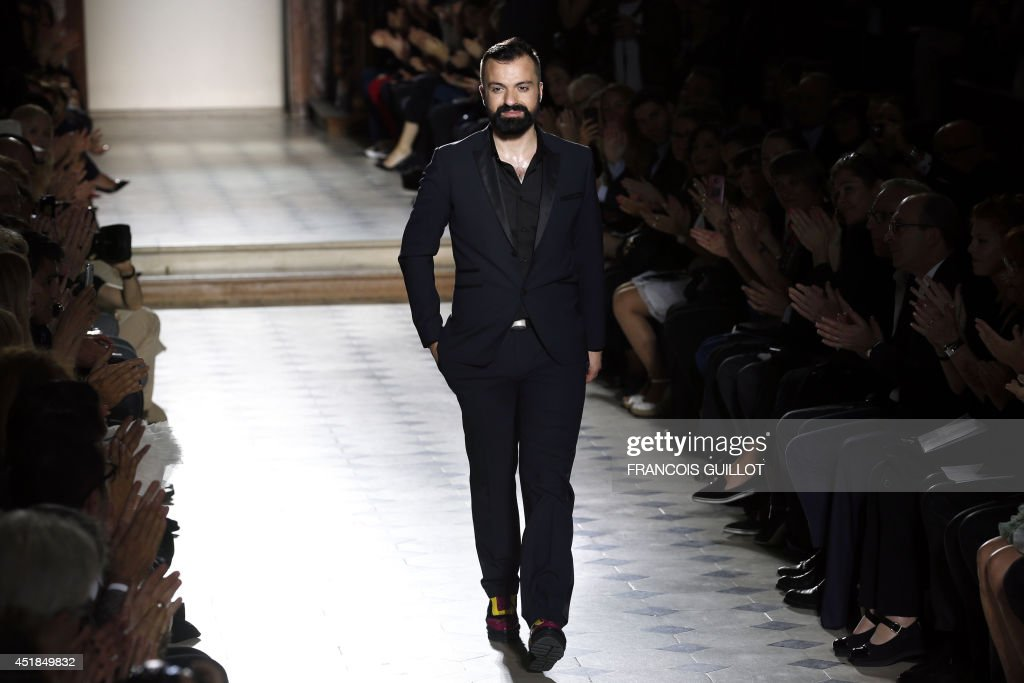French fashion designer Julien Fournie acknowledges the public at the end of his 2014/2015 Haute Couture Fall-Winter collection fashion show on July 8, 2014 in Paris.