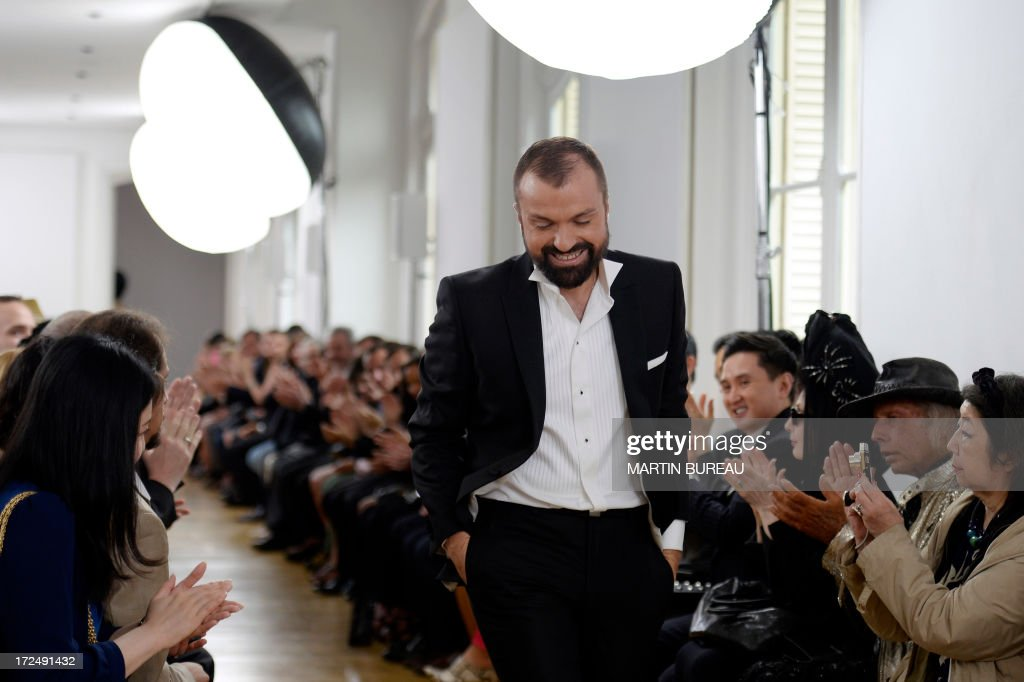 French fashion designer Julien Fournie acknowledgest the public during his Haute Couture Fall-Winter 2013/2014 collection show, on July 2, 2013 in Paris. AFP PHOTO/MARTIN BUREAU