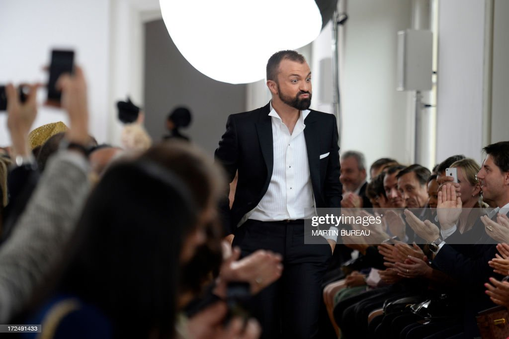 French fashion designer Julien Fournie acknowledgest the public during his Haute Couture Fall-Winter 2013/2014 collection show, on July 2, 2013 in Paris.