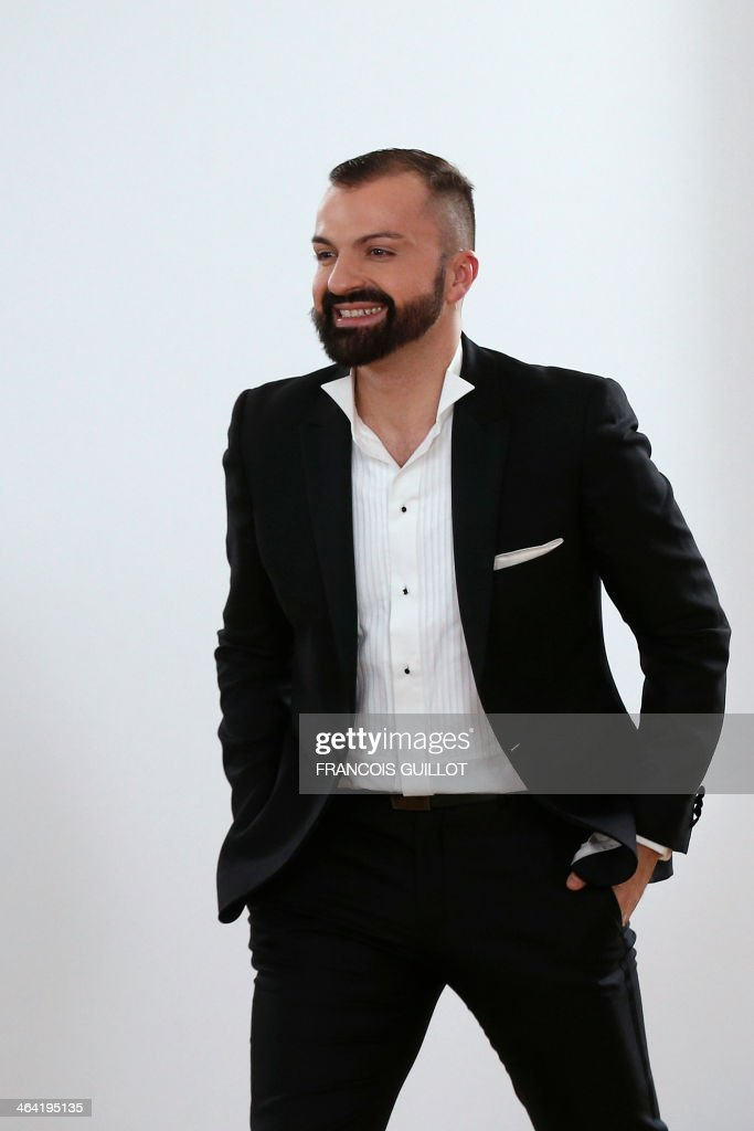 French fashion designer Julien Fournie acknowleges the public at the end of his Haute Couture Spring-Summer 2014 collection show, on January 21, 2014 in Paris. AFP PHOTO / FRANCOIS GUILLOT