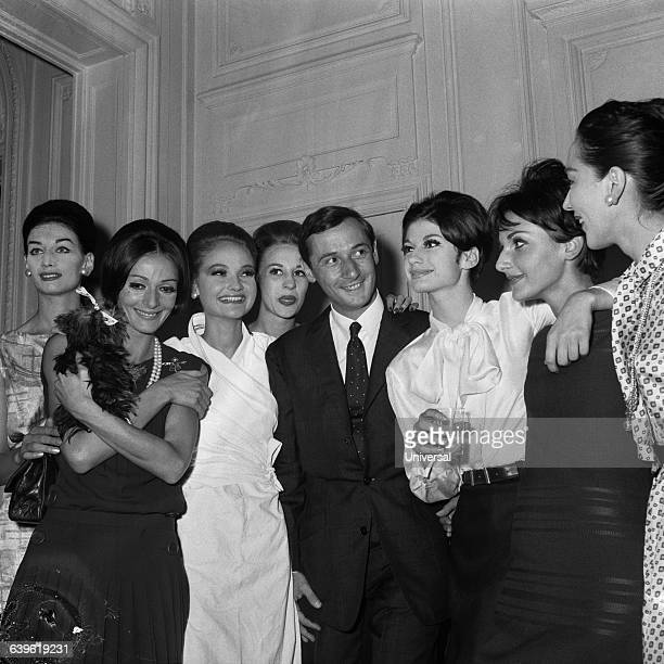 French fashion designer Marc Bohan is congratulated by models after a Dior fashion show