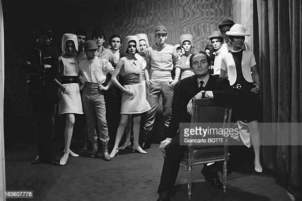 French fashion designer Pierre Cardin poses with his models in France in 1967
