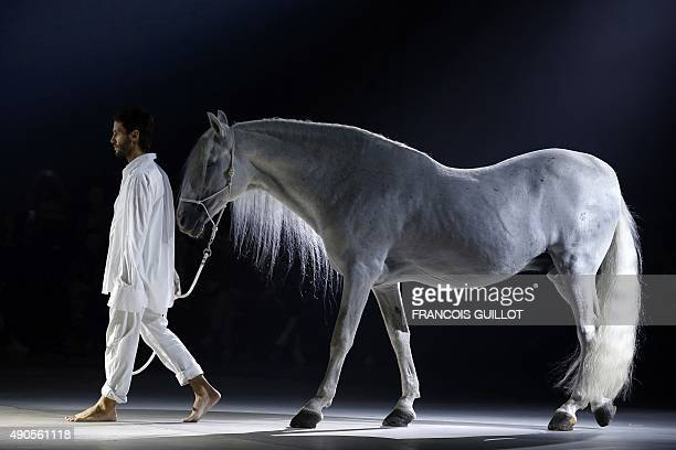 French fashion designer Simon Porte for Jacquemus walks with a horse during his 2016 Spring/Summer readytowear collection fashion show on September...