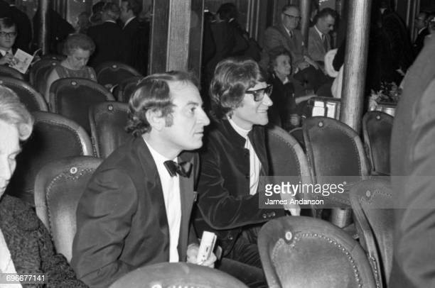 French fashion designer Yves Saint Laurent and his partner Pierre Bergé attend the 'Revue of 1968' at the Folies Bergères theatre in Paris 9th...