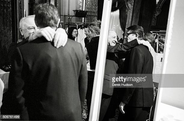French fashion designer Yves Saint Laurent and Pierre Berge backstage during preparations for a fashion show Paris France 2005