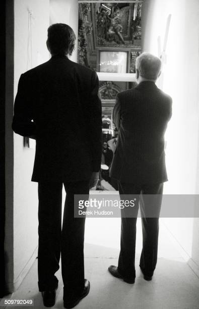 French fashion designer Yves Saint Laurent and Pierre Berge watch from backstage during a fashion show Paris France 2005