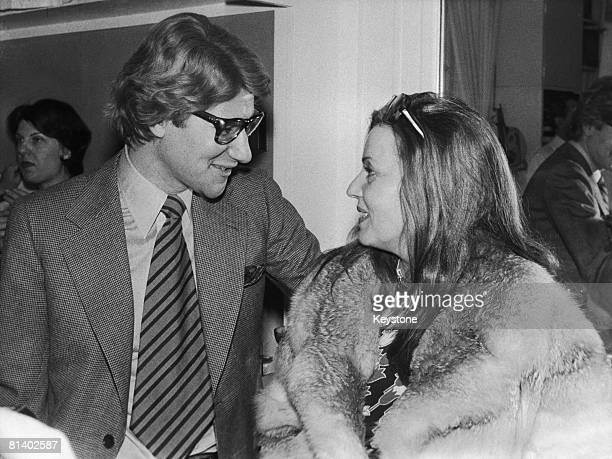 French fashion designer Yves Saint Laurent with French actress Jeanne Moreau after the launch of his spring and summer collection Paris 30th January...