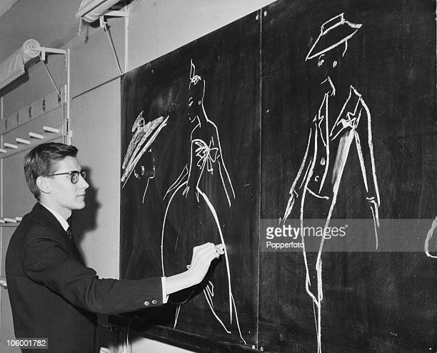 French fashion designer Yves Saint Laurent working on new designs at the House of Dior in Paris circa 1960