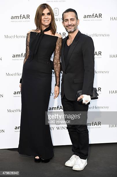 French fashion editor Carine Roitfeld and US designer Marc Jacobs pose as they arrive for the amfAR dinner on the sidelines of the Paris fashion week...