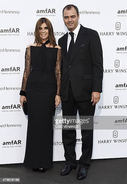 French fashion editor Carine Roitfeld and US film producer Milutin Gatsby pose as they arrive for the amfAR dinner on the sidelines of the Paris...