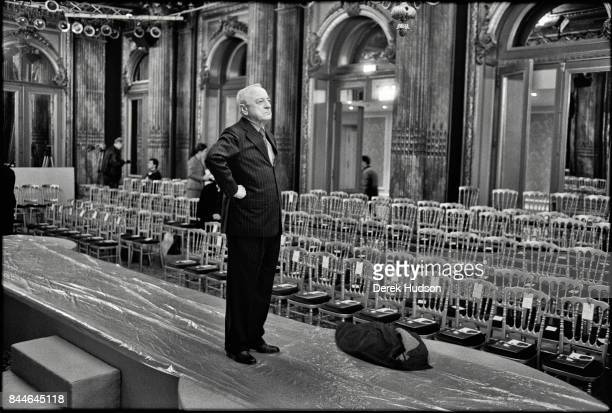 French fashion patron Pierre Berge stands on the catwalk during preparations for an Yves Saint Laurent haute couture runway show at the Hotel Meurice...