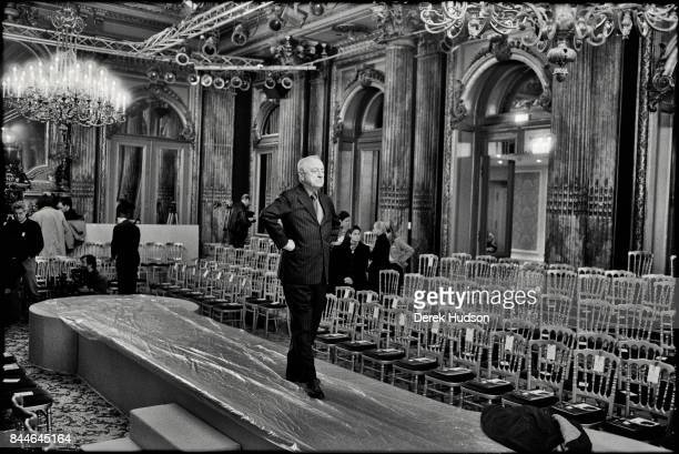 French fashion patron Pierre Berge walks on the catwalk during preparations for an Yves Saint Laurent haute couture runway show at the Hotel Meurice...