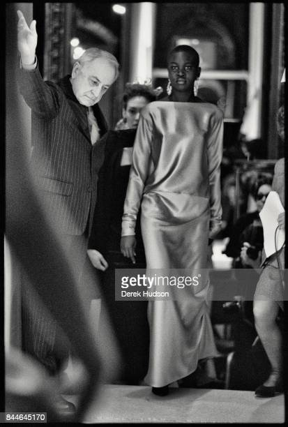 French fashion patron Pierre Berge waves models in from the wings at an Yves Saint Laurent haute couture runway show at the Hotel Meurice Paris...