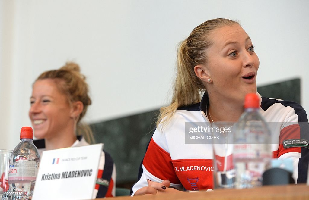 French Fed Cup tennis team players <a gi-track='captionPersonalityLinkClicked' href=/galleries/search?phrase=Pauline+Parmentier&family=editorial&specificpeople=607686 ng-click='$event.stopPropagation()'>Pauline Parmentier</a> (L) and <a gi-track='captionPersonalityLinkClicked' href=/galleries/search?phrase=Kristina+Mladenovic&family=editorial&specificpeople=4835181 ng-click='$event.stopPropagation()'>Kristina Mladenovic</a> react at the International Tennis Federation Fed Cup final draw ceremony on April 17, 2015 in Ostrava. The Fed Cup semi-final, Czech Republic against France, is scheduled on April 18-19, 2015.