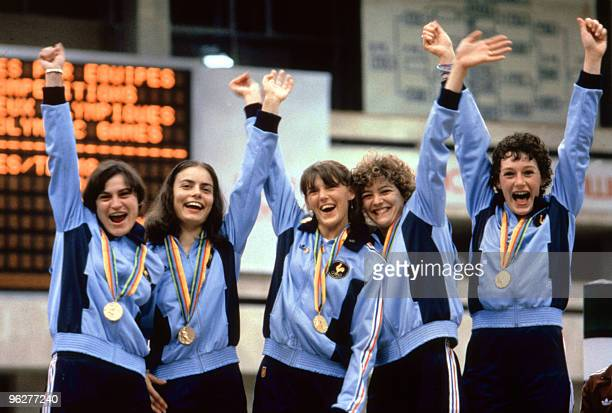 French female fencing team smile and raise their arms on the podium after they won gold in the Ladies Foil Team category Olympics Moscow July 1980...