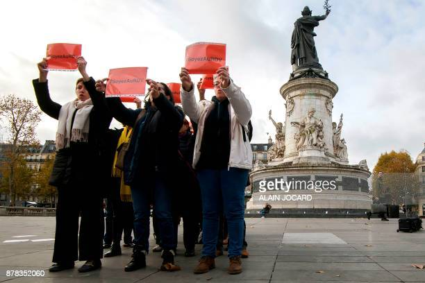 French feminist Caroline de Haas and members of 'Les effrontees' feminist movement hold sign during a protest against violences on women at the place...