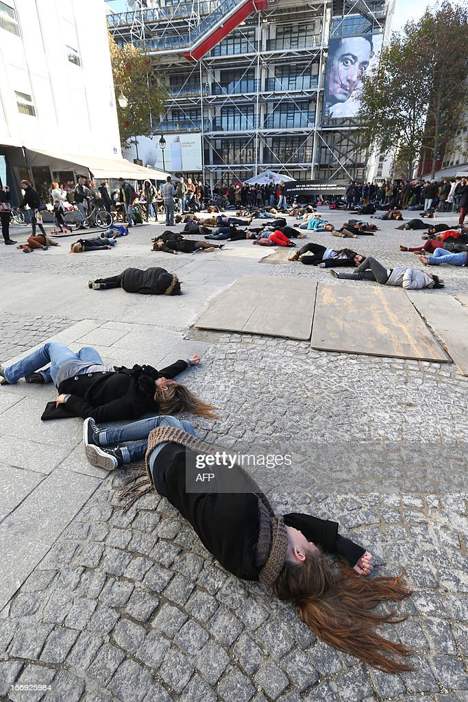 French feminists of the 'Ni Putes, Ni Soumises' (Neither Whores Nor Submissive - NPNS) movement lie on the ground to simulate agressions on November 25, 2012 in front of the Centre Pompidou art center (aka Beaubourg) in Paris during the International Day for the Elimination of Violence Against Women. Since 1999, the United Nations each year invites governments, international organizations and NGOs to organize activities designed to encourage the public to fight such violence.