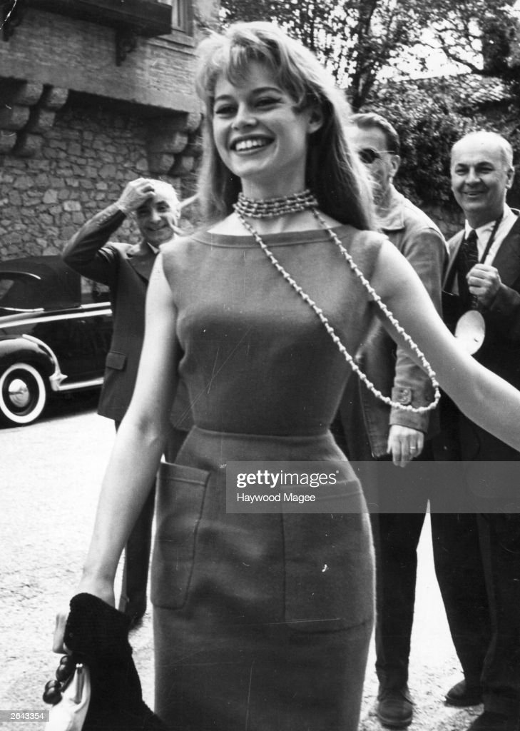 French film actress <a gi-track='captionPersonalityLinkClicked' href=/galleries/search?phrase=Brigitte+Bardot&family=editorial&specificpeople=202903 ng-click='$event.stopPropagation()'>Brigitte Bardot</a> arriving at Cannes Film Festival. Original Publication: Picture Post - 8378 - Discovery At Cannes - pub. 1956