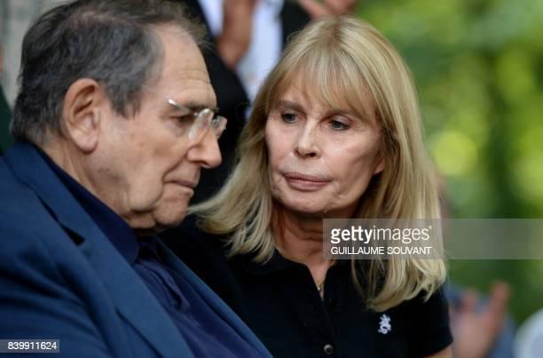 French film and stage director Robert Hossein and his wife French actress Candice Patou attend the 22th La Foret Des Livres book fair on August 27...