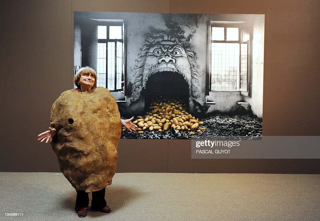 French film director Agnes Varda photographer and artist poses on November 24 2011 with 'Madame Patate' suit created for the 2003 Venise biennial in...